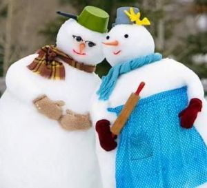 This may be seen as a cute snow couple. But I like how the snow lady wears her dress and carries a rolling pin. And how the snowman wears a pot for on his head.