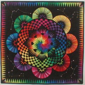 Yes, this is another rainbow pattern. But this one uses thin triangle and checker rings to form a star.