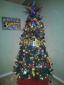 "It even has the word ""Superman"" around it as well as yellow, red, and blue ribbons. And the Man of Steel is on top."