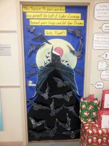 This is a door decoration for a school. Kids write on the bats. Not sure about Batman in a Santa hat.