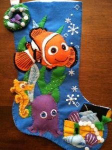 This one has Nemo with his little friends. Sure the snowflakes don't fit in with the coral reef landscape. But this is for Christmas.