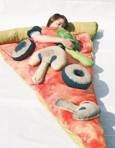 I'm sure anyone who loves the great outdoors would want to sleep on a slice of pizza with plush toppings of broccoli, mushrooms, and olives. Available on Etsy for $200.