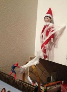 Because he just got caught in Spider Man's web. Great work, Spidey. The Elf on the Shelf needed to go.