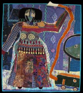 And she seems to be holding a snake. Still, if Picasso did quilting, he'd probably do something like this.