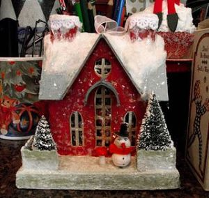 This red one also has 2 chimneys, a snowed roof, and 2 trees. Like the snowman.
