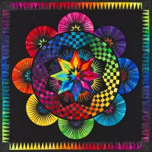 This one an improvement on a previous quilt. Love the rainbow scheme as always.