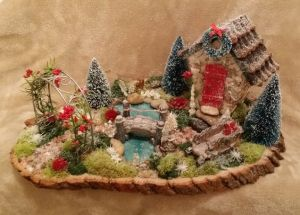This one uses a Christmas wreath and other holiday touches. So simple yet so quaint.