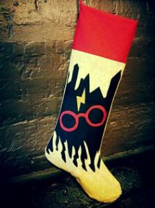 This one has Hogwarts, Harry's lightning bolt scar, and glasses. Is also in red and yellow Gryffindor colors.