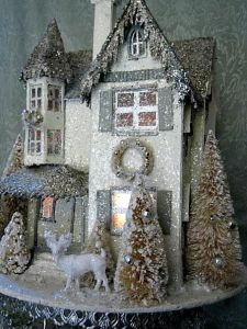 This one has a glittery roof as well as other Christmas decor. Got to love the white reindeer in the front.