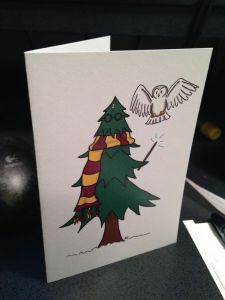 This one has Harry as a tree with his glasses, wand, and Gryffindor scarf. And Hedwig is by his side.