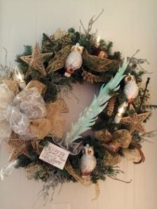 This one has owls, stars, quill, and a scroll with writing. Certainly a Harry Potter Christmas wreath if there was one.