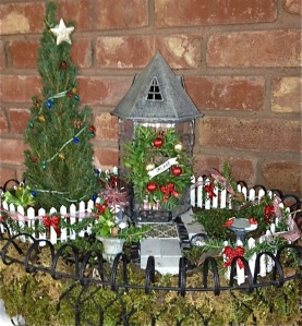 This one has a tower decorated with a wreath and garlands. Also like the tree.