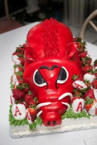 Actually it's a Razorback cake that salutes Arkansas. But it's surrounded by strawberries.