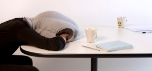 "It's the kind of pillow that allows you to nap on your desk while on the job. Might be the kind of gift that says, ""I hear you don't get enough sleep and are under a lot of stress."""