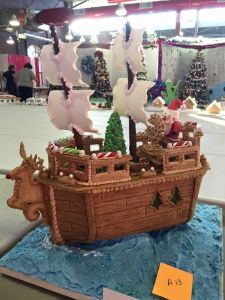 Santa on a wooden ship with his Christmas tree on the deck. However, it's certainly clear he's either running this ship by magic or with an elf crew.