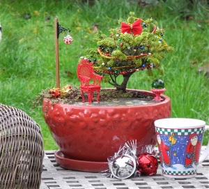 This bonsai tree even has a bow and beads around it. And it goes nicely with the red chair.
