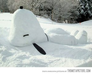 Though he usually rests on top of his dog house. But this is quite a snow sculpture I had to put on this post.