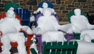Funny how they're made from the snow that covers the chairs. Doesn't seem to take much work to do.