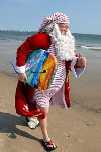 And here he is in an old fashioned swimsuit about to go surfing. Not sure if he'll succeed riding the waves.