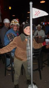 This woman is dressed up as Flick from A Christmas Story. You know the kid who stuck his tongue on the flag pole.