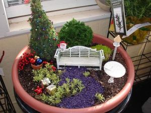 This one has presents, a tree, Santa, and baubles on a pot. Like the white bench and table though.