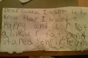 This kid doesn't seem very happy. Yeah, please rub it in Santa's face, how could you?