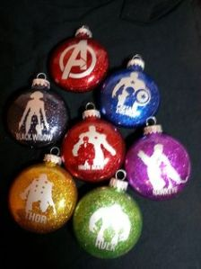 Each Avenger silhouette is in a respective color. And one includes the Avengers logo.