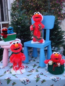 They consist of Elmo with candy canes, garlands, and a sack of presents. So cute.