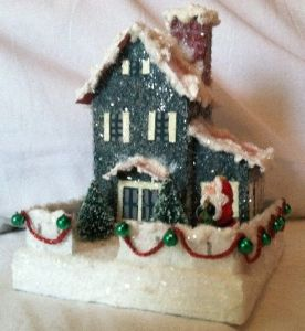 It even has green jingles with red beads as well as Santa in front. Love the shutters.