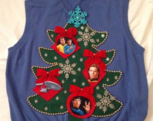 Has ornaments of Kirk, Spock, and the Enterprise on a Christmas tree. Hope it helps the wearer to live long and prosper.