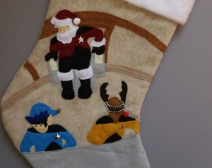 This one features Picard as Santa and LaForge with reindeer antlers. Guess they had a Christmas party before someone attacked them.