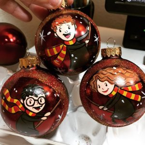 These baubles depict Harry, Ron, and Hermione on broomsticks. Got to love these.