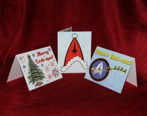 Consists of a Klingnon Christmas tree, Santa hat Starfleet insignia, and a Starlfeet insignia pulled by reindeer. A very Trekkie way to wish your loved ones well.