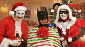 Because Batman is held hostage. to add insult to injury, Joker and Harley even put him on their Christmas card.
