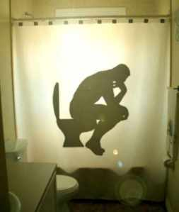 And here he is sitting on the toilet like a modern man. Except that he's naked.