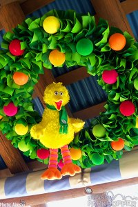 Just a green rag wreath with pom poms. Like seeing Big Bird with a scarf.