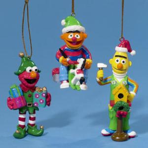 Well, Elmo is dressed as an elf. Ernie makes a rocking horse. Yet, Bert builds a birdhouse, most likely for his pigeons.