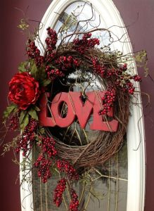 After all, it says love in wooden letters. Love the flowers and berry branches, too.