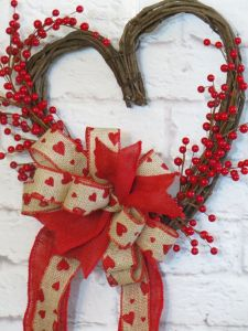 Well, the berries are fake and sure aren't holly. But they'll do. Love the hearts on the bow, too.