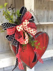 Well, this is a lovely decoration for V-Day. Love the bow. Not sure about the foliage.