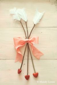 Now these look quite easy to make. Just have feathers, twigs, ribbon, and red hearts.
