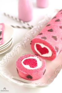 Yes, it's another cake roll. But this one is pink with chocolate hearts. And it has a darker pink heart in the center.