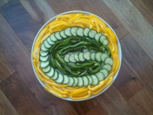 Includes peppers and cucumber slices. Best to go with some cheese dip naturally.