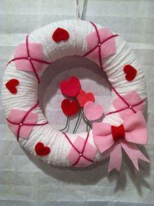 Well, it's a lovely wreath of white and pink. But most of the hearts are red.