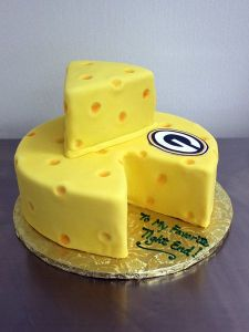 I'm not sure if it's a real cheesecake. But it's shaped like a cheese to any Packer fan's delight.