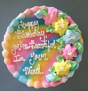 Now that doesn't sound very nice. Sure we're self-deluded in our looks to some extent. But that doesn't mean we should put it on a birthday cake.