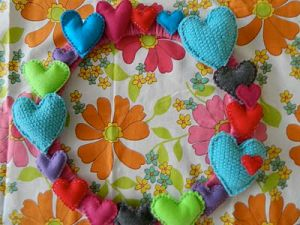On this wreath, you'd find hearts of all kinds of colors and sizes. For those who aren't fond of pink, this is for you.