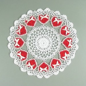 Each red heart is surrounded with lace and has a pink bow. All in all, so beautiful.
