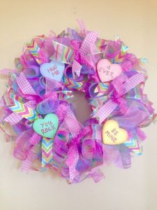 Each heart has a sweet saying among a pastel wreath. So lovely.