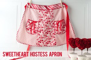 It has hearts all over it along with cute little pockets. Great for any V-Day party.
